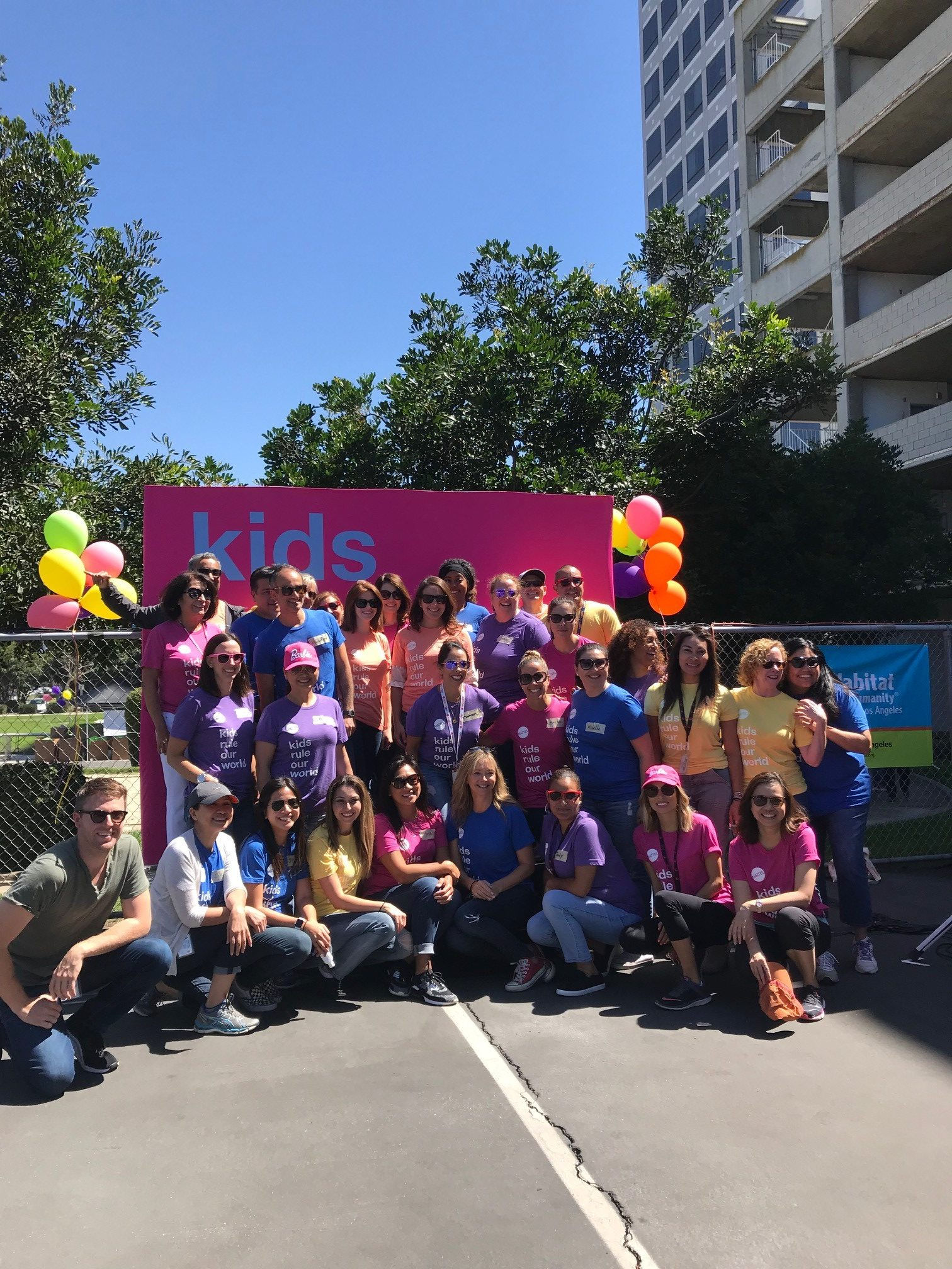 All of the Mattel volunteers standing for a group photo.