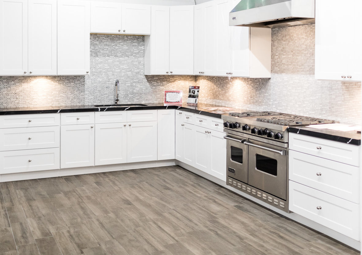 Photo of white cabinets in a new kitchen.