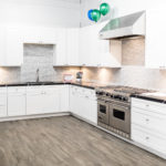 White kitchen cabinets in a newly remodeled kitchen.