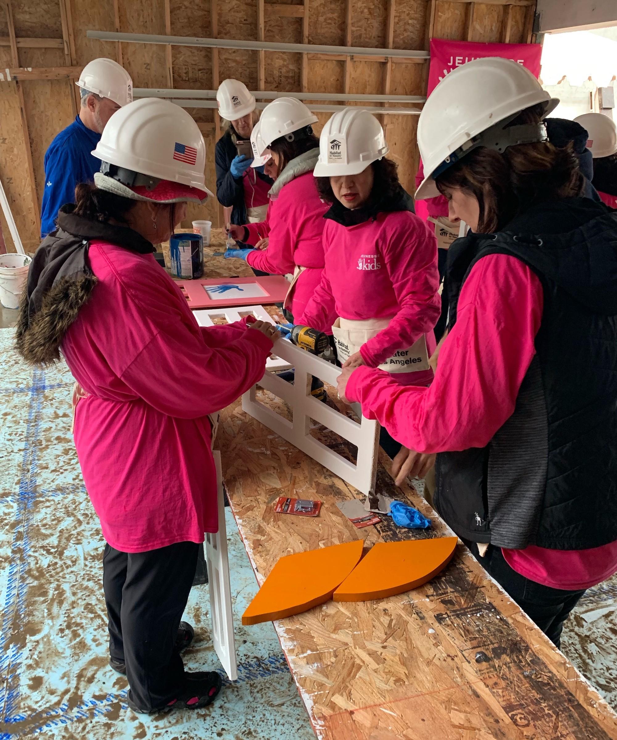 Jeunesse Kids distributors working on a playhouse.