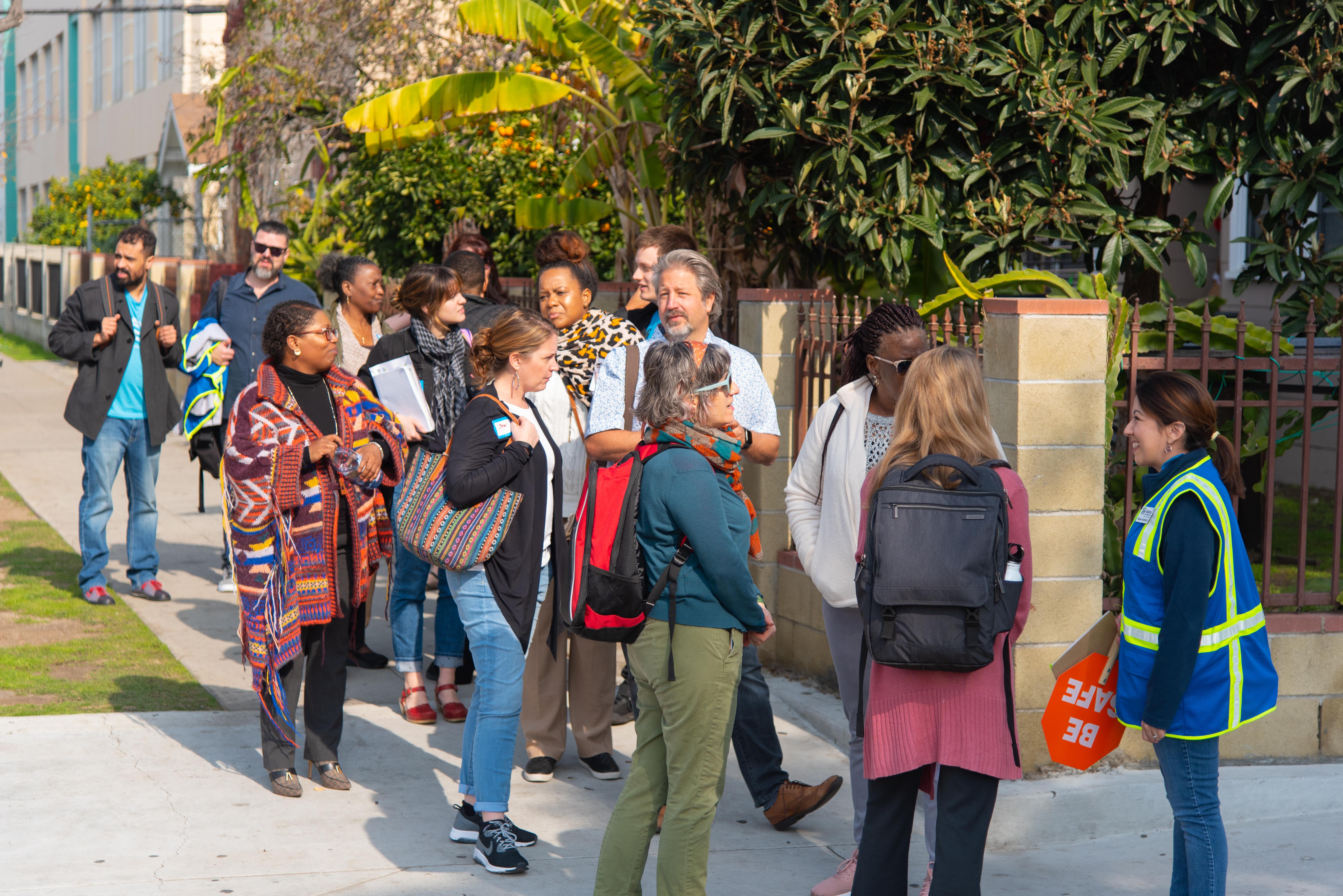 Habitat LA Staff leading a group through the Washington Neighborhood.