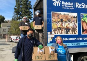 Habitat LA ReStore tucks helping during COVID-19 by delivering meals and pet food.