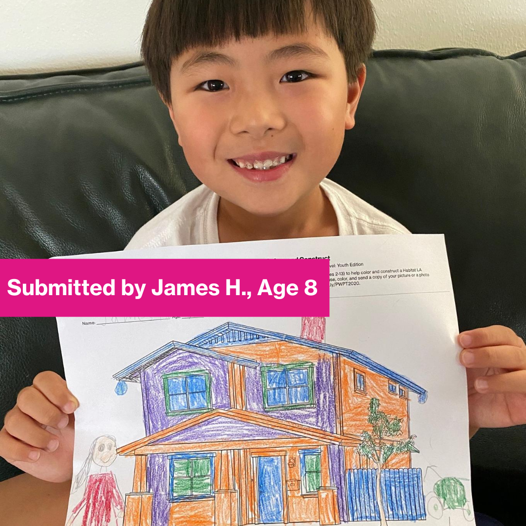 Child contestant holding his drawing.