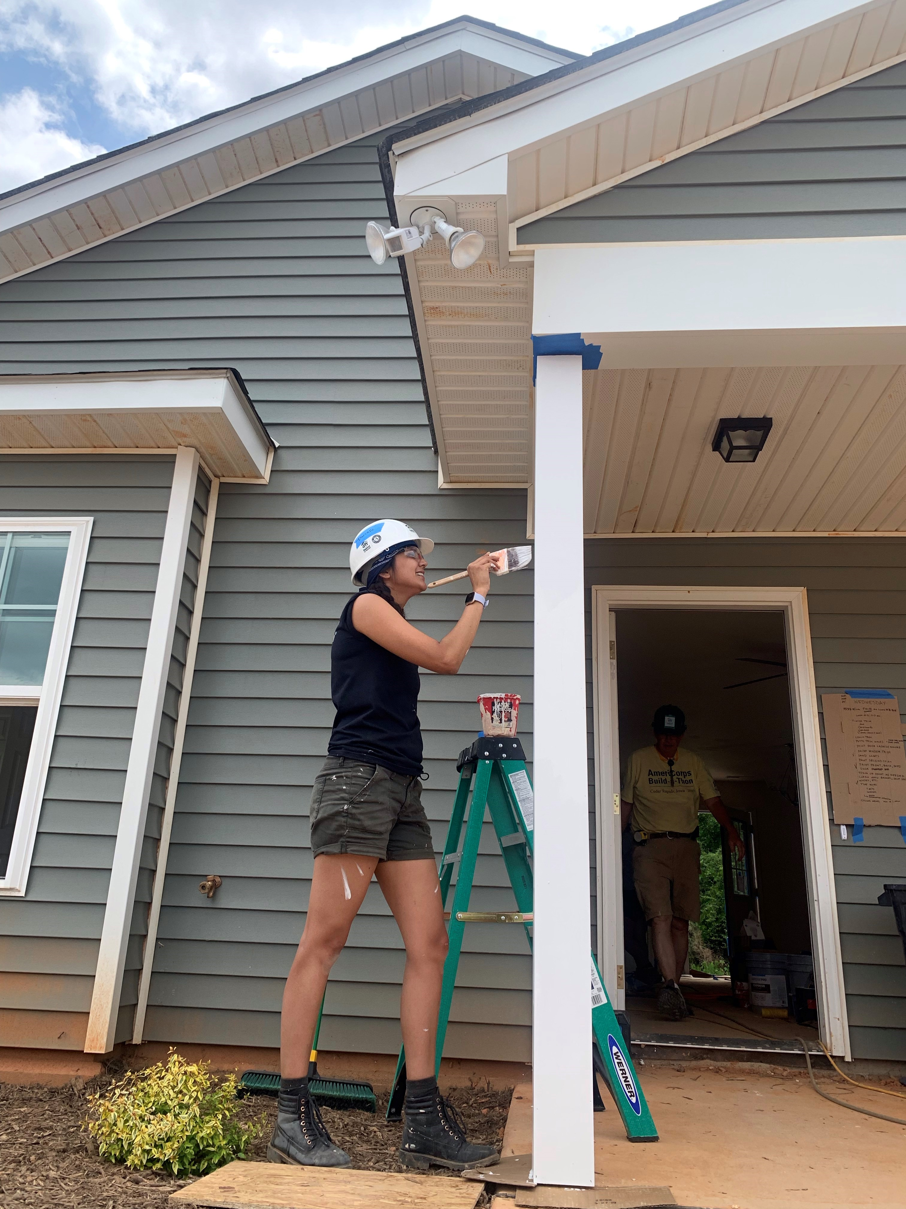Previous AmeriCorps, Danielle, painting a house