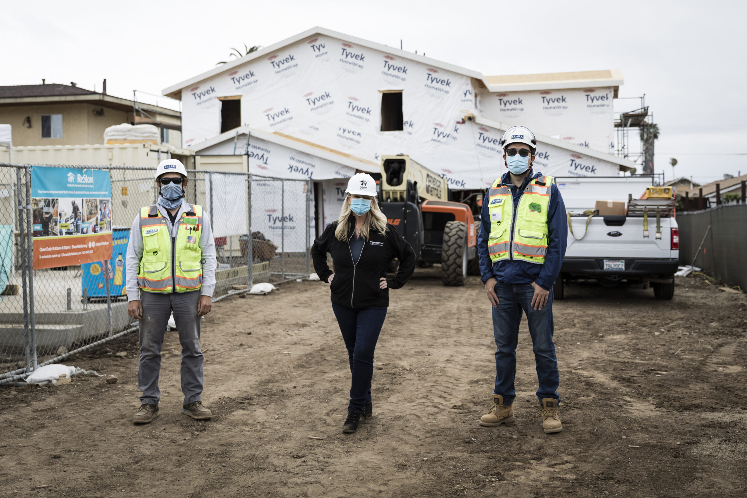 three people standing on site for the 2021 Home Builders Blitz.